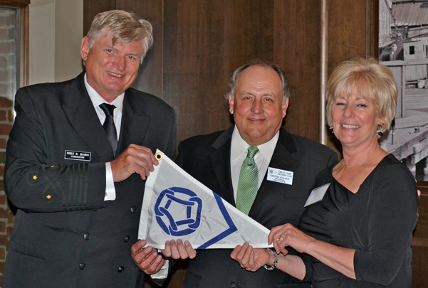 2014: Past Commodore Niels Jensen presented 25-year Member Port Captain burgee to Port Captains Chester and Ceann Kolascz